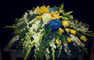 Blues and yellows casket spray